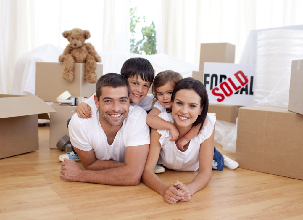Image for Conveyancing page - Happy family lying on floor after buying new house
