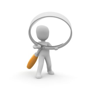 Image for Conveyancing - First Time Buyer - Man holding magnifying glass